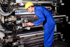 professional printer operating modern industrial printing machine